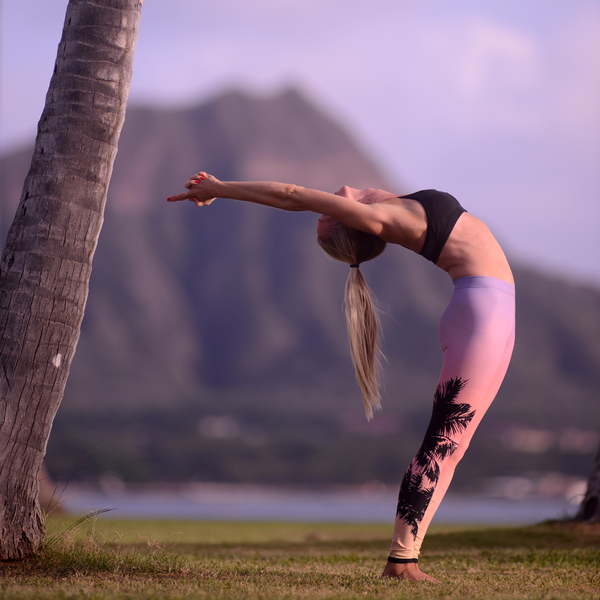 Yoga instructor Kathryn McCann practices a backbend while overlooking Diamond head in Oahu, Hawaii.