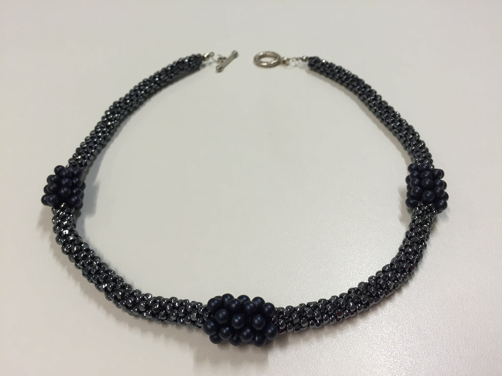 Shining twilight necklace boasting deep blue embellishments, with silver fastening