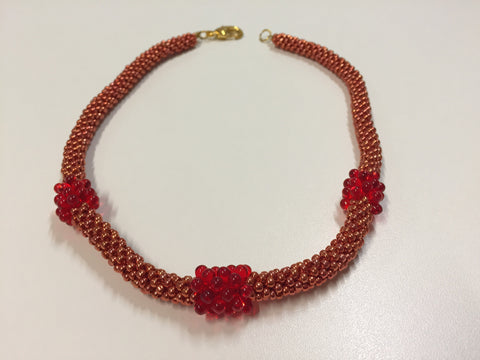 Dazzling Rouge necklace with gold clasp.jpg