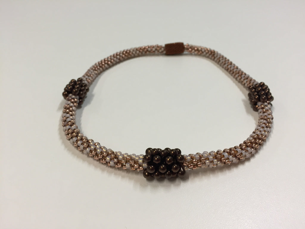 Beautiful hand-crafted copper-gold necklace with dark chocolate embellishments