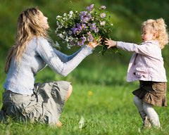 mother and girl with flowers