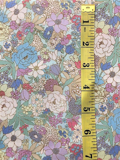 Fabric - Floral - Medium Scale Multi Coloured Flowers on Soft Blue Background