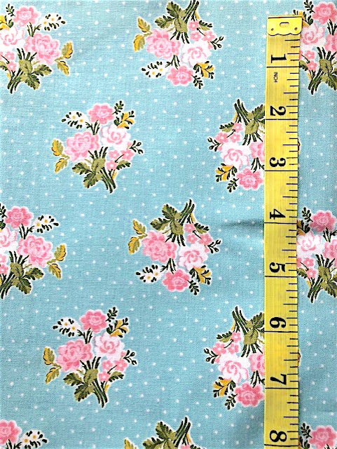 Fabric - Floral - Small Bunches of Pink Flowers on an Blue Background with White Spots