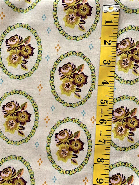 Fabric - Floral  - Trio of Flowers surrounded by a circle cartouche on soft yellow/green background