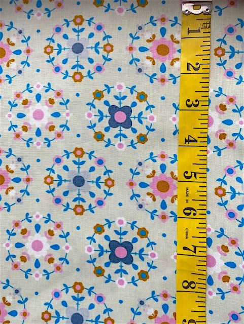 Fabric - Floral - Small Flowers set in circles on putty coloured background