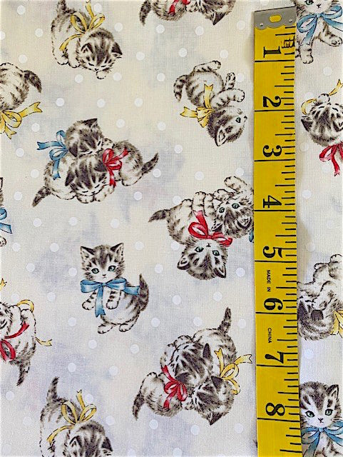 Fabric - Childrens Prints - Kittens with Ribbons on Cream Background with white spots