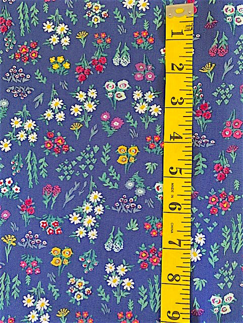 Fabric - Floral - Small bunches of Multi Coloured Flowers on Blue Background