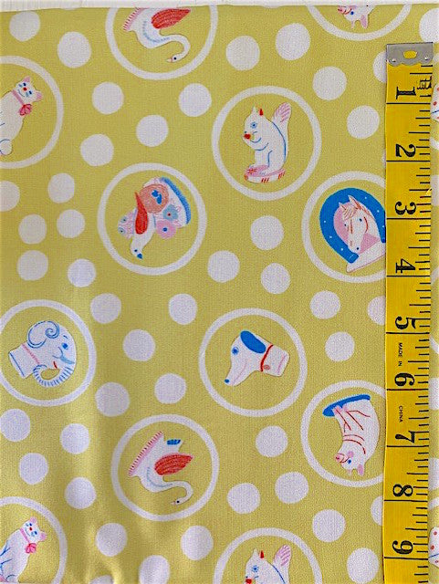 Fabric - Childrens/Novelty - Animals & Toys Circled in White with White Spots on Yellow