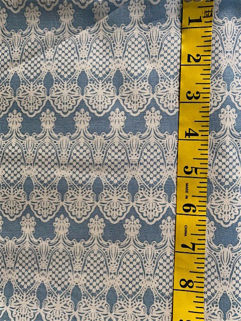 Fabric - Stripes - Stylised Cream Lacey Design on Blue Background