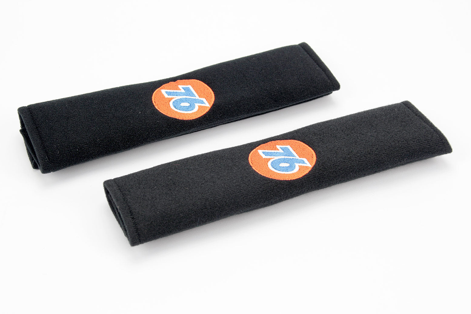 76 Gasoline logo embroidered on padded seat belt covers.