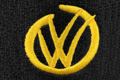 VW logo in a graffiti style shown in yellow embroidery