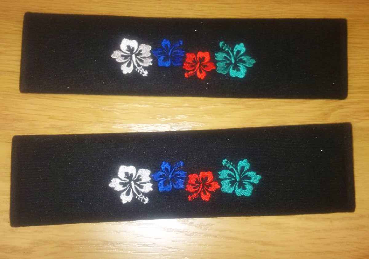 Multicoloured Hibiscus flower Padded seat belt covers.