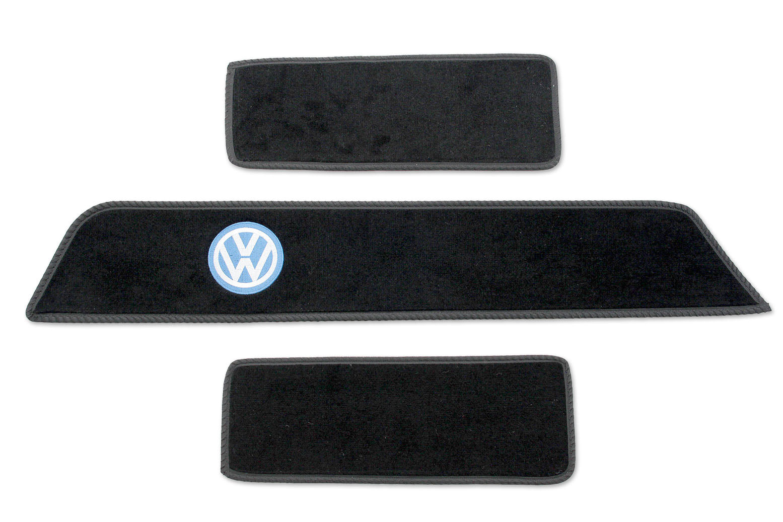 T6 side steps mats with classic blue logo shown on black automotive carpet