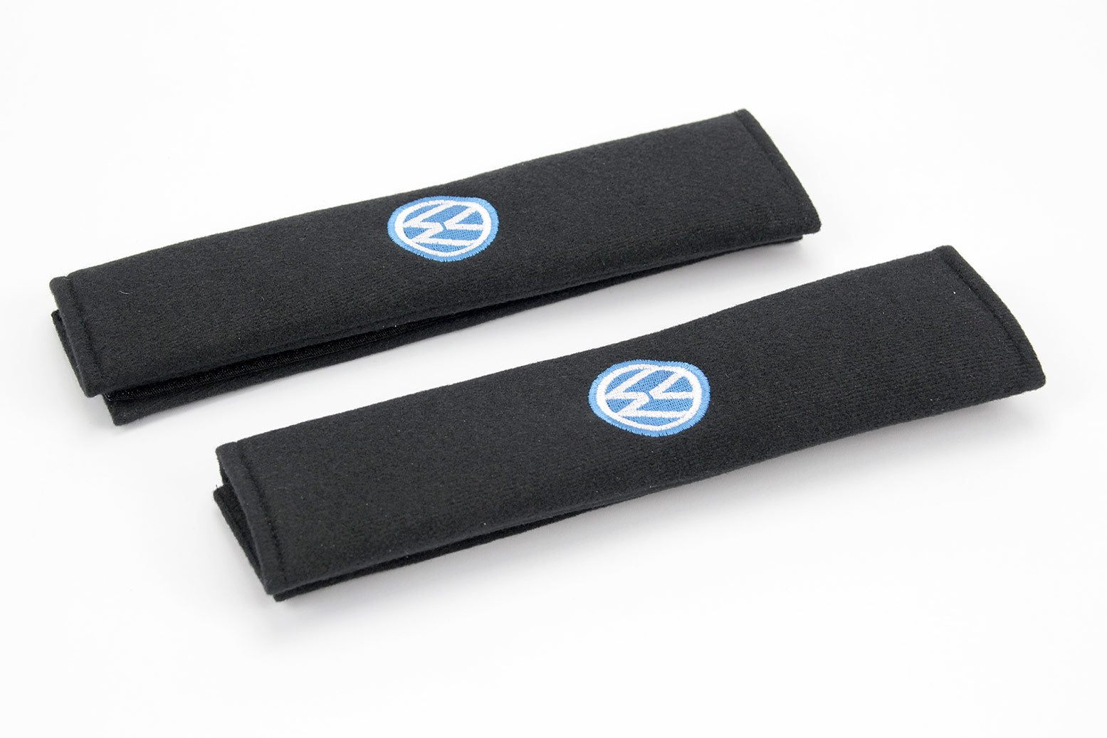 VW logo embroidered on padded seat belt covers.