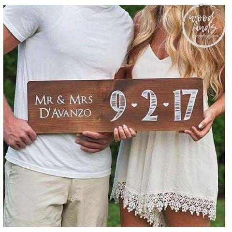 mr and mrs on wood with wedding date