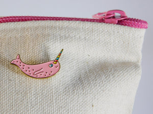 Narwhal enamel pin on a zipper pouch