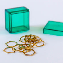 Load image into Gallery viewer, Set of 15 Gold Hexagon Stitch Markers in Emerald Green Storage Box
