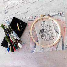 Load image into Gallery viewer, Embroidery Kit comes with everything you need, including a printed pattern, backer fabric and felt, a hanging hook, needle and floss -- and a hoop