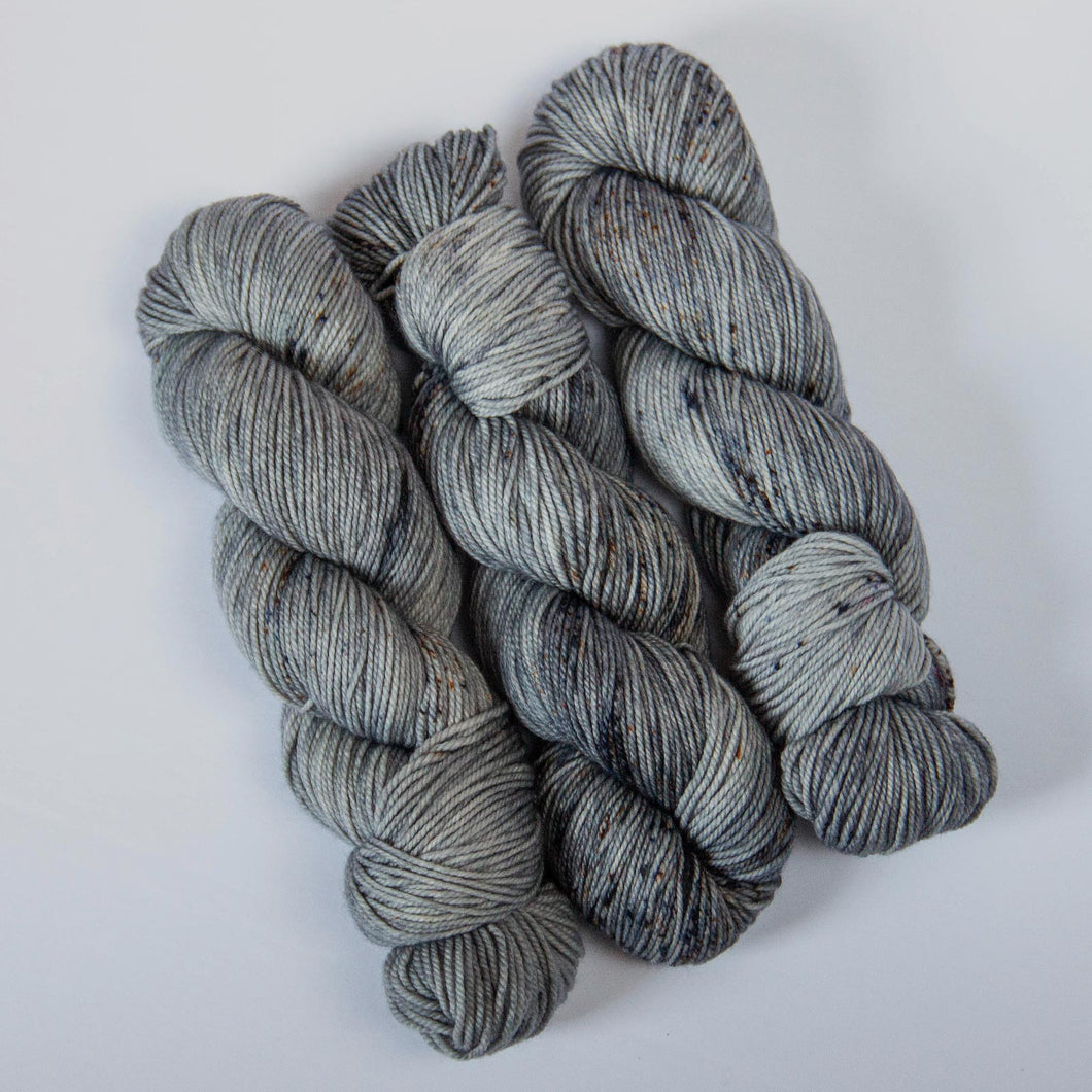 Hand Dyed DK Merino Yarn in Gray -- Spotted Silverware