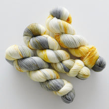 Load image into Gallery viewer, speckled hand dyed sock yarn in gray and mustard yellow -- grellow