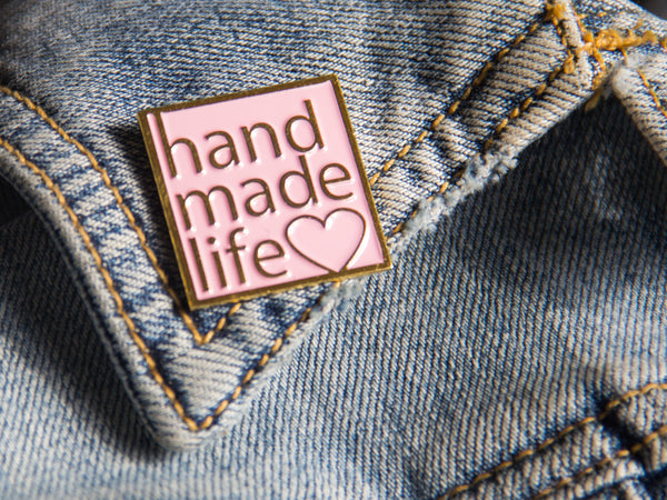 handmade life love pink and gold enamel pin on denim jacket lapel