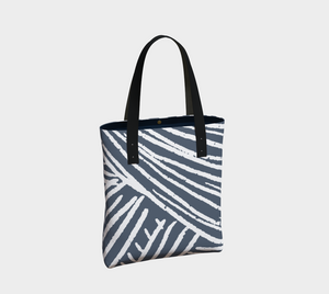 blue and white abstract printed vertical lined tote bag with zipper pocket