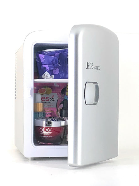 Uber Appliance Gun Metal Beauty Fridge 4 Liter Capacity with make up, skin care and cosmetics inside the fridge with the door propped open
