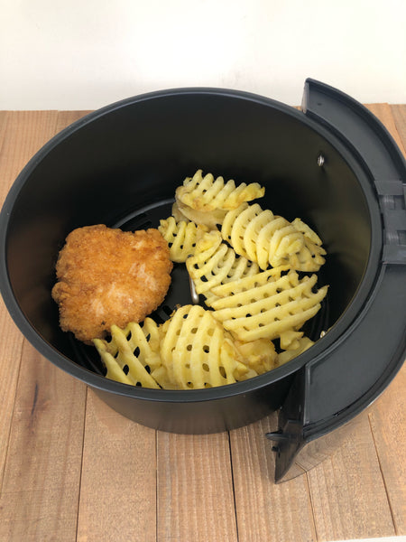 Chicken breast filet and waffle fries in an Uber Air Fryer XL Basket