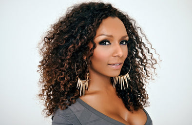Portrait of Janet Mock activist and entertainment host on her book Redefining Realness