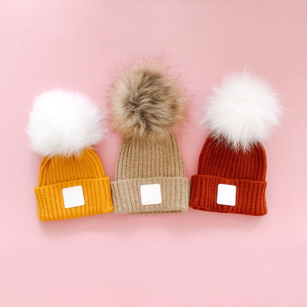 """minimalist"" hat with pompom"