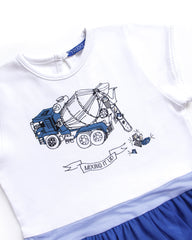 close-up detail of a dress with and image of cement mixer truck with jewels spilling out