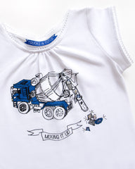 close-up detail of a t-shirt with and image of cement mixer truck with jewels spilling out