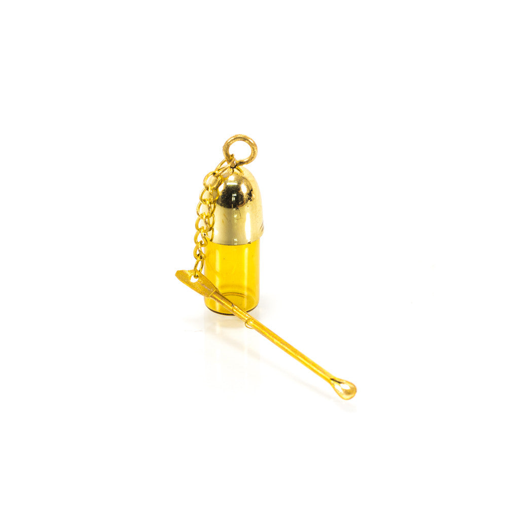VIAL WITH GOLD SPOON