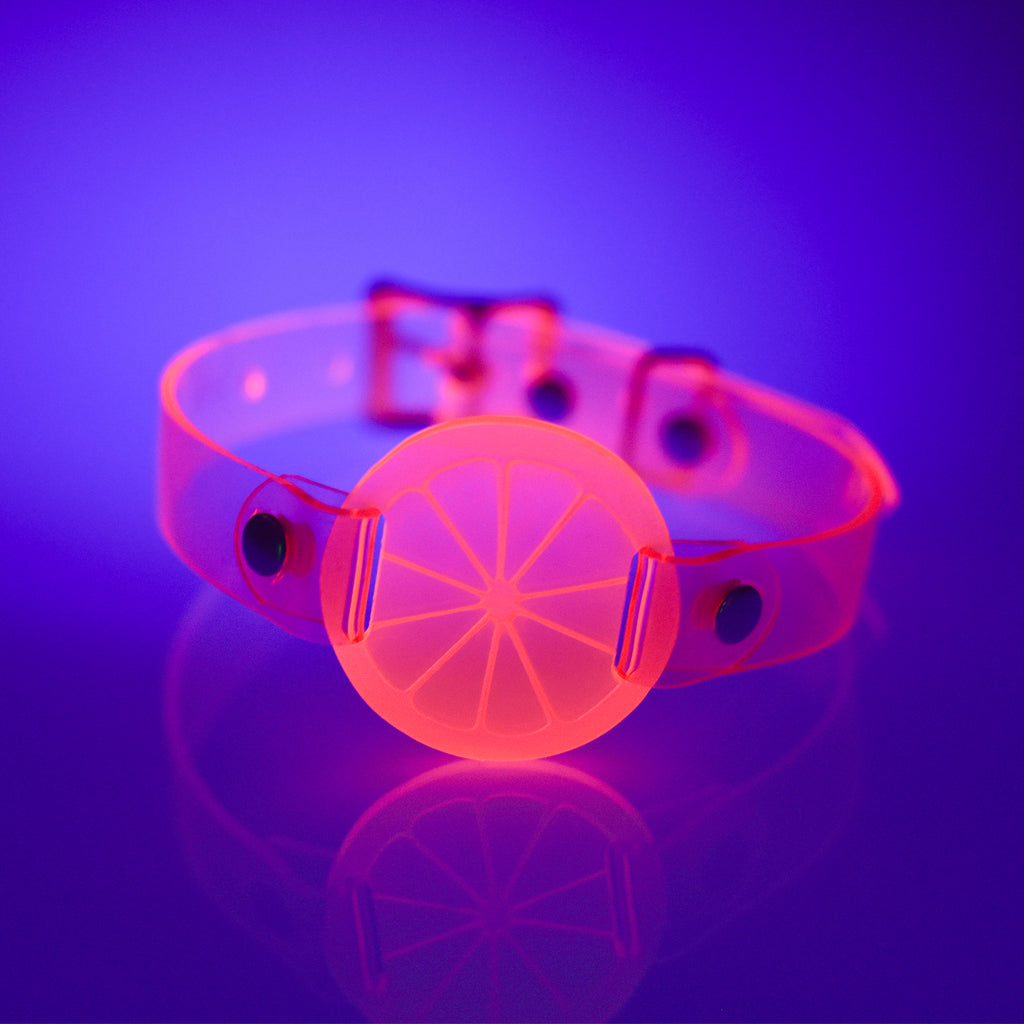 Apatico and Anhedonie choker collar in neon uv pink with acrylic citrus center.