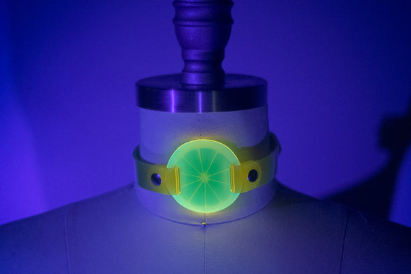 Apatico and Anhedonie choker collar in neon uv yellow with acrylic citrus center.