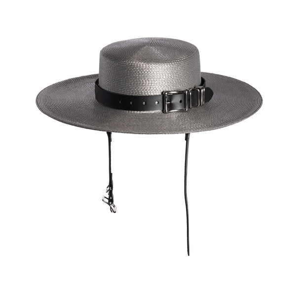 Gray and black wide brimmed faux straw hat with harness straps and buckle band.
