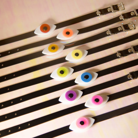Apatico eyeball choker collars in a rainbow of colors for Pride.