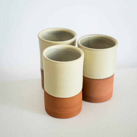 Tall terracotta beakers