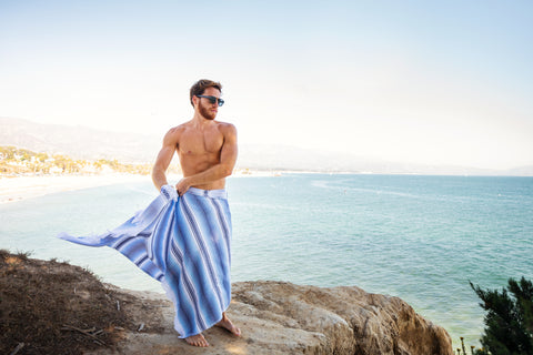 Man using a Riviera Towel as a Sarong  Turkish Towel