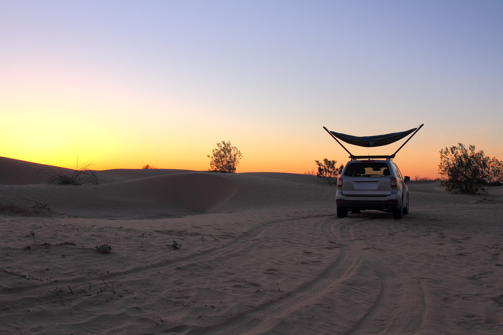 TrailNest Roof Top Hammock Stand in use during a desert sunset