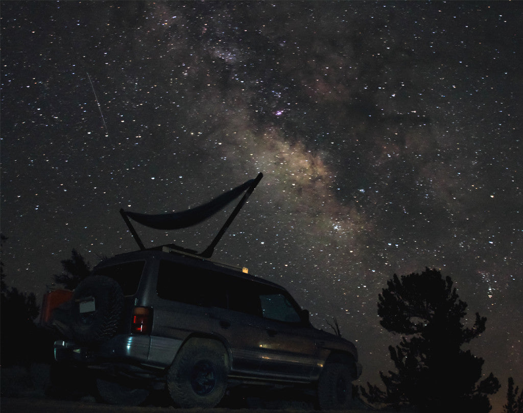 Camping under the stars in the TrailNest Roof Top Hammock Stand