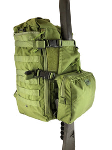 MR40 backpack with rifle secured behind the attached Loady with fold up panel