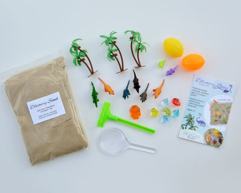 Sensory Dinosaur World Discovery Kit by Revelae Kids with molding sand