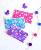 Enchanted cloth snack bags by Revelae Kids are decorated with magical unicorns and rainbows, princesses and colorful mermaids
