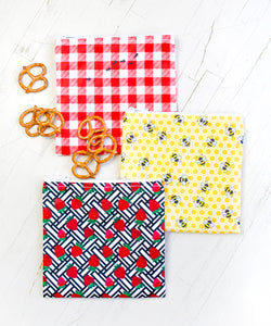 Revelae Kids Picnic cloth sandwich bag set with gingham pattern and ants, strawberry print and honeycomb pattern with honey bees