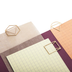 Three geometric paperclips in brass