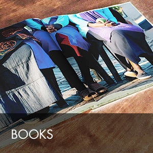 The Kaross book is a beautiful, hand-bound 200 page photo journal of the history and people of Kaross featuring their African Art and hand embroidered items.
