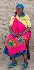 Anna Mashaba - Kaross embroiderer since 1993 - in traditional dress with nceka