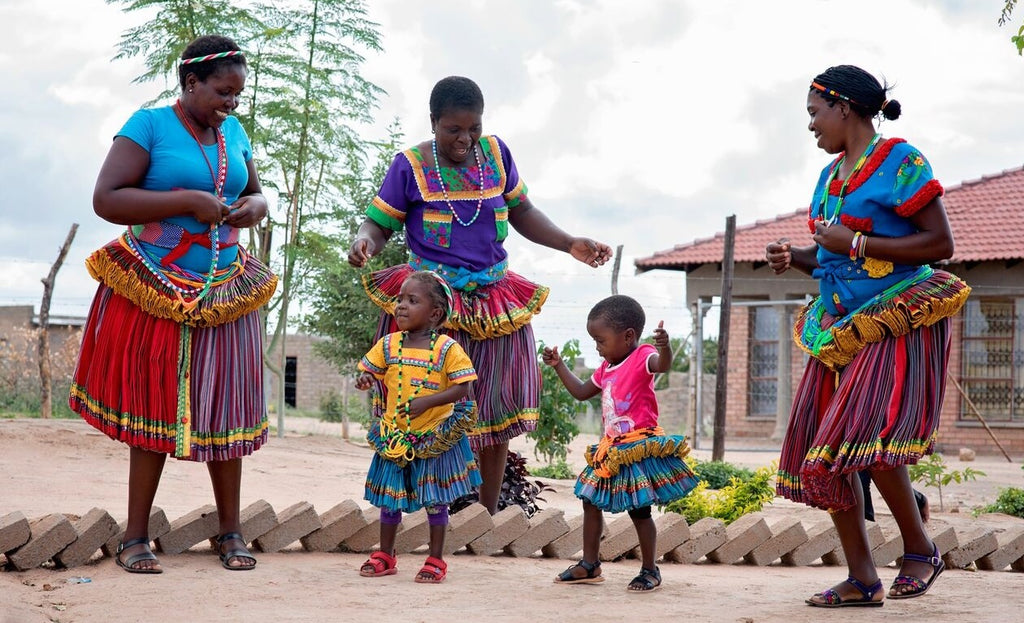Mashaba family embroiderers and children dancing in vibrant cultural dress