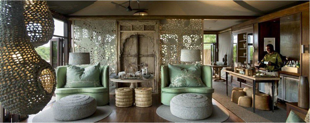 Kaross hand-embroidered cushions featured as decor in a South African game lodge